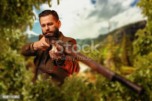 658114236 istock photo Hunter sitting in the bushes and aiming a rifle. 658114360
