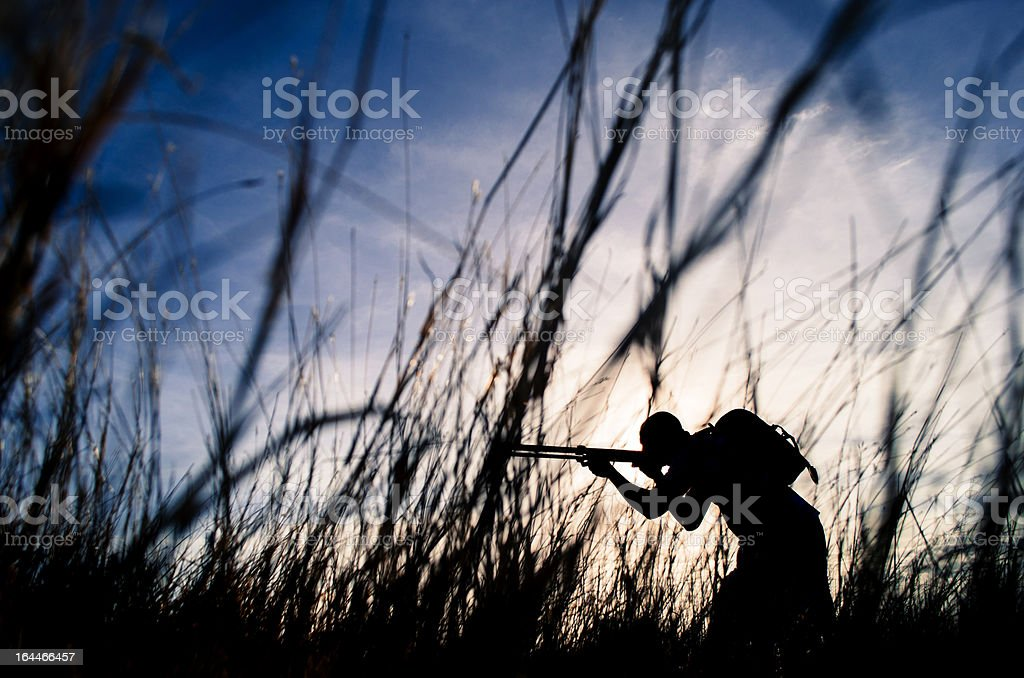 hunter sniper in bushes stock photo