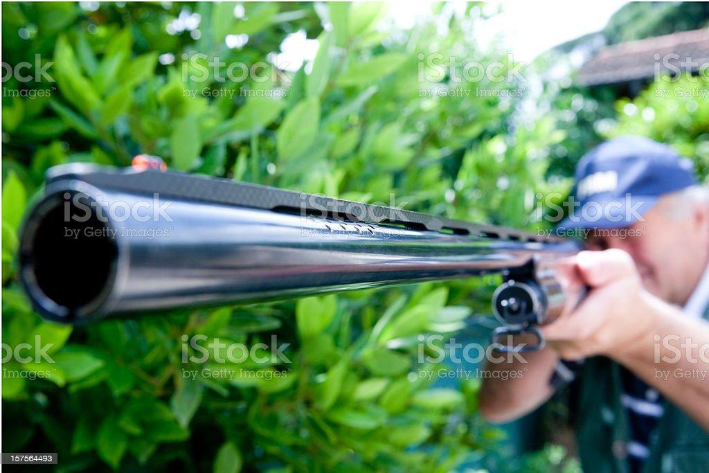 Hunter with big rifle royalty-free stock photo