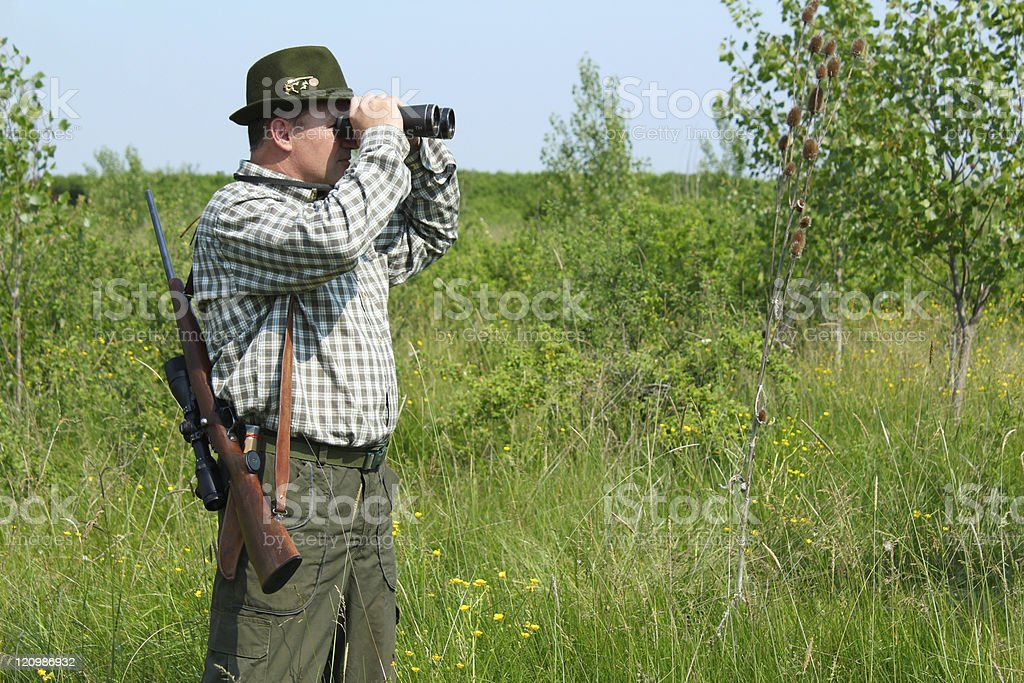 hunter with binoculars looking for venison royalty-free stock photo
