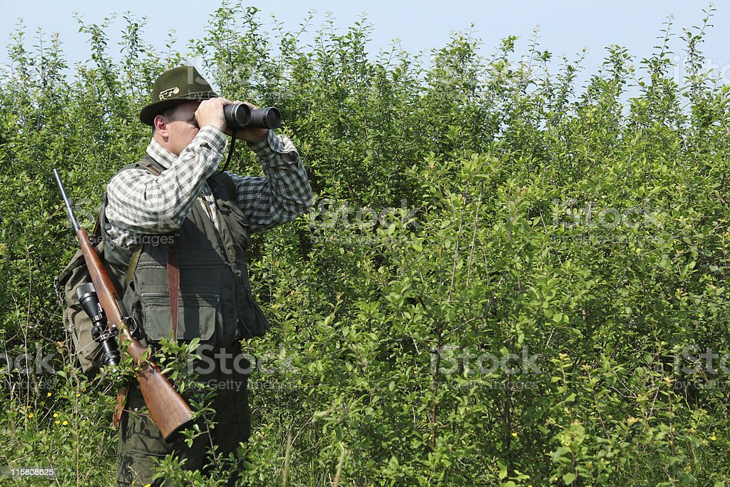 hunter with binoculars royalty-free stock photo