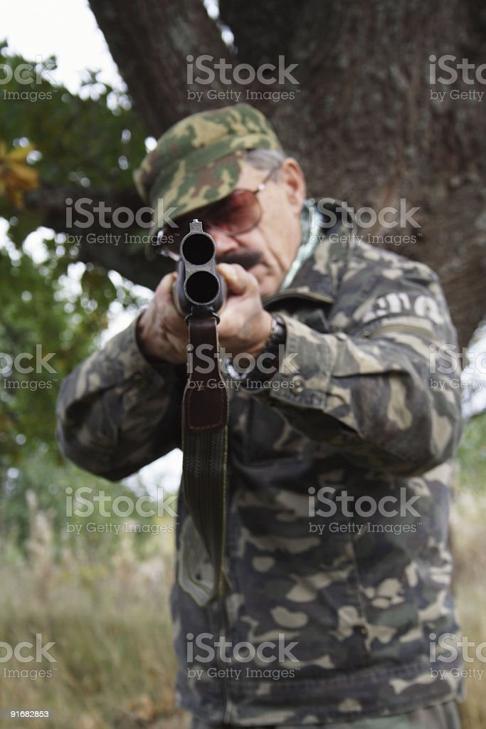 Hunter with double barrel gun royalty-free stock photo