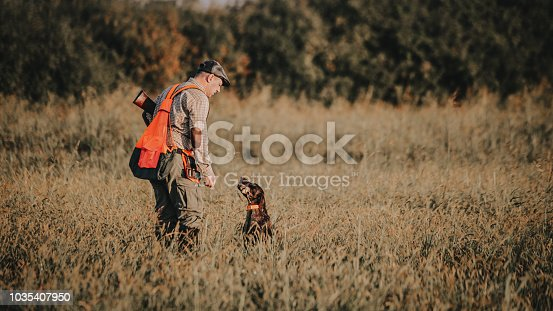 Hunter with hunting dog during a hunt