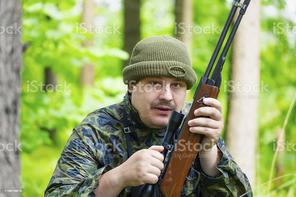 Hunter with optical rifle royalty-free stock photo