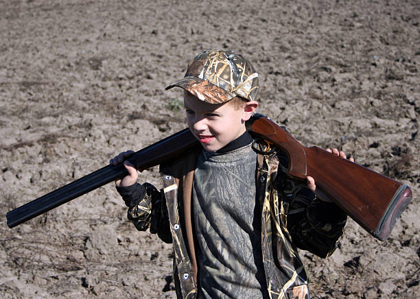 hunters helper boy helping on his first hunt snow goose stock pictures, royalty-free photos & images