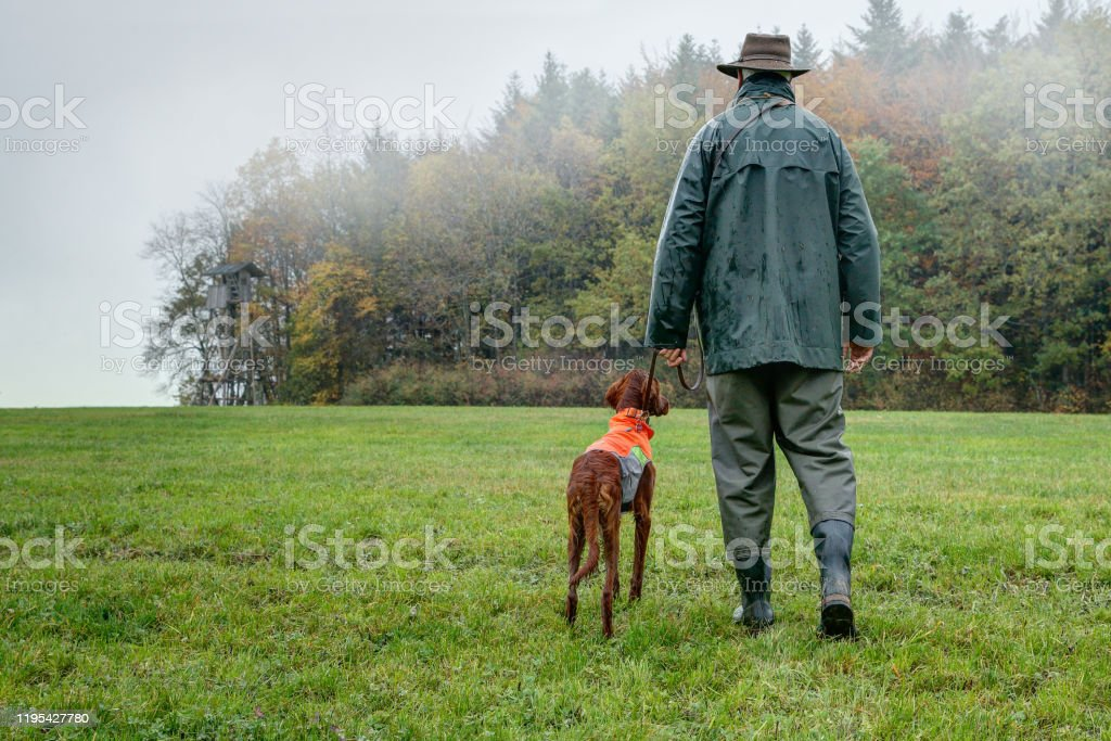 Hunters stalk through their hunting grounds. - Royalty-free Active Seniors Stock Photo