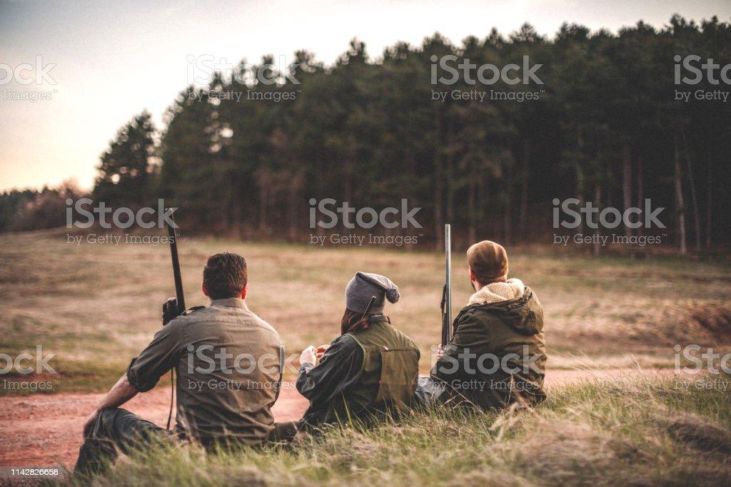 Hunters taking a break of long walk