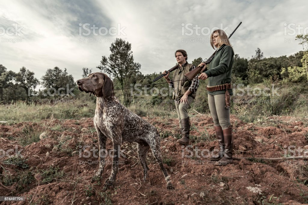Hunters with German Shorthaired Pointer stock photo