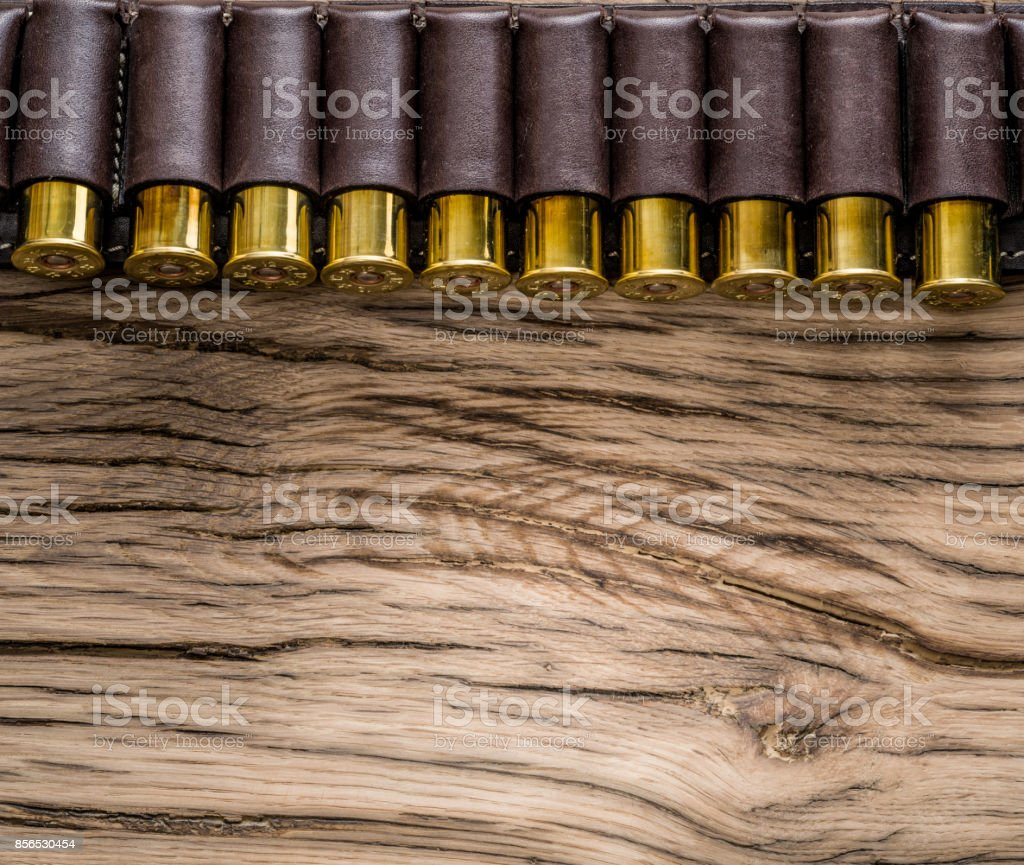Hunting cartridge for pump shotgun on the wooden table. stock photo