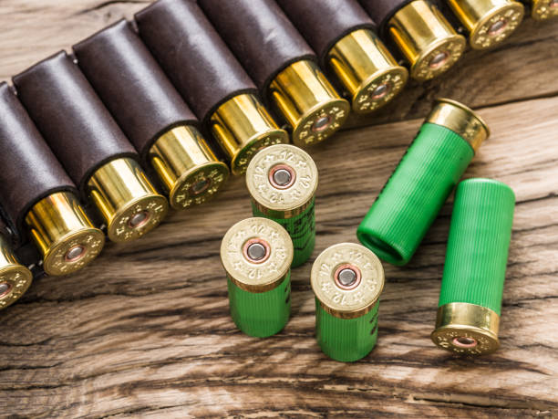 Hunting cartridge for pump shotgun on the wooden table. Hunting cartridge for pump shotgun on the wooden table. ammunition stock pictures, royalty-free photos & images