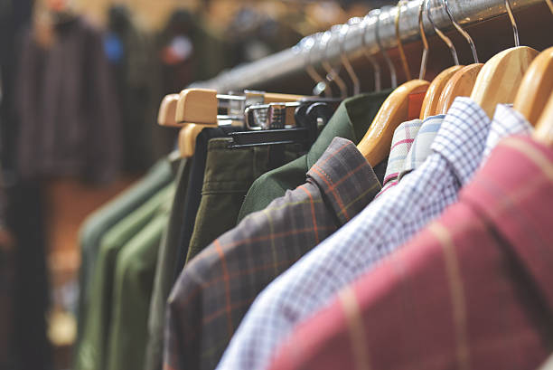 hunting clothing in army shop - giyim eşyası stok fotoğraflar ve resimler