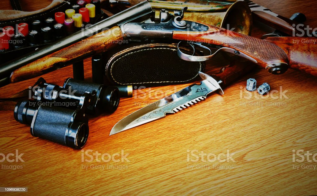 Hunting equipment on a wooden background stock photo