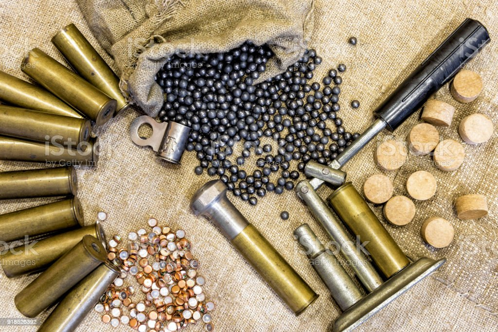hunting equipment on the background of an old sacking. Brass shells, hunting shot concept as background stock photo