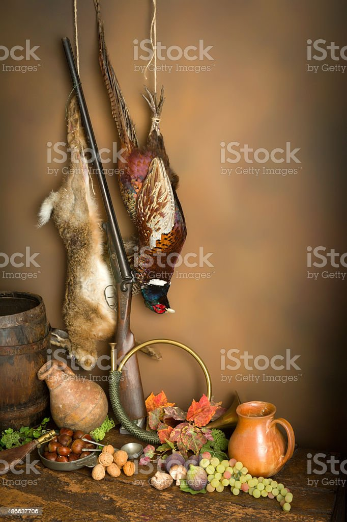 Hunting horn and game stock photo