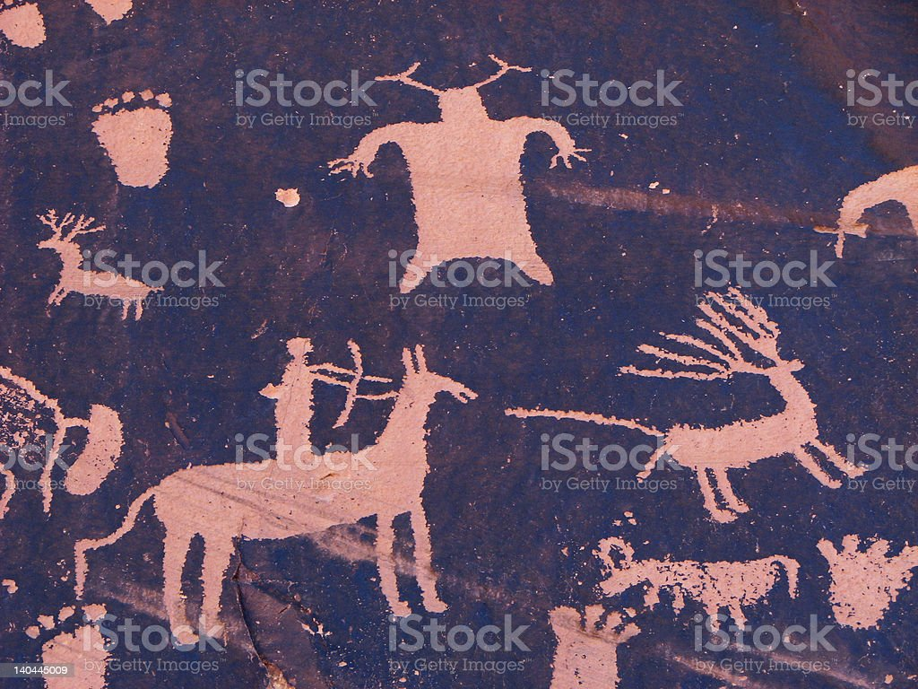 hunting petroglyph stock photo