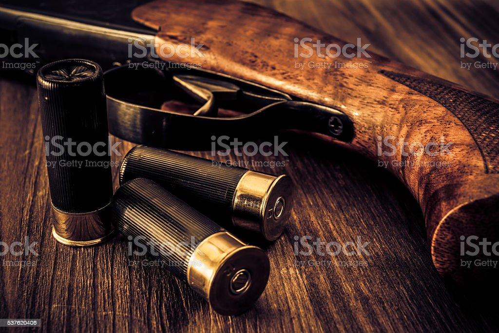 Hunting rifle with ammunition stock photo