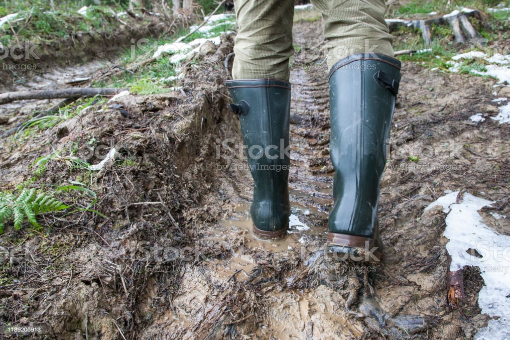 Hunting rubber boots in heavy terrain - Royalty-free Adult Stock Photo