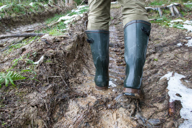 Hunting rubber boots in heavy terrain stock photo