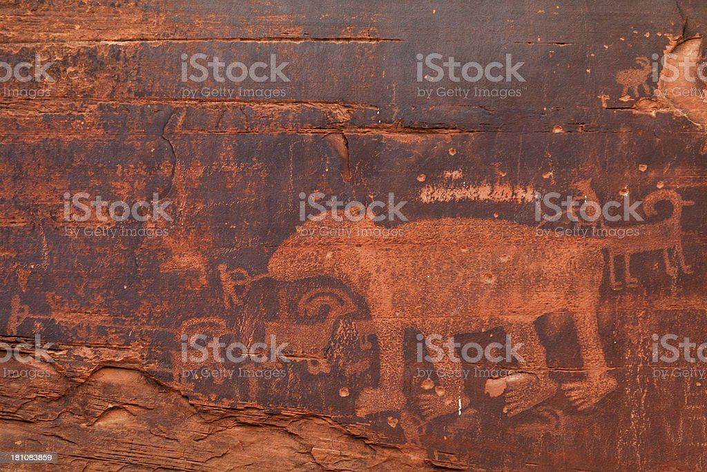Hunting scene, rock art, ancient petroglyphs, Moab, Utah, USA stock photo