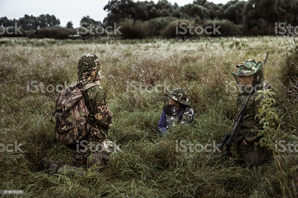 hunting scene with group of hunters in rural field stock photo