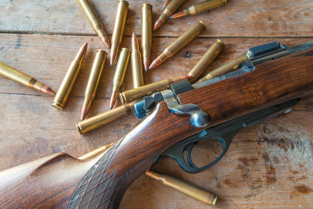Hunting season concept Hunting gun with bullets on old wooden background ammunition stock pictures, royalty-free photos & images