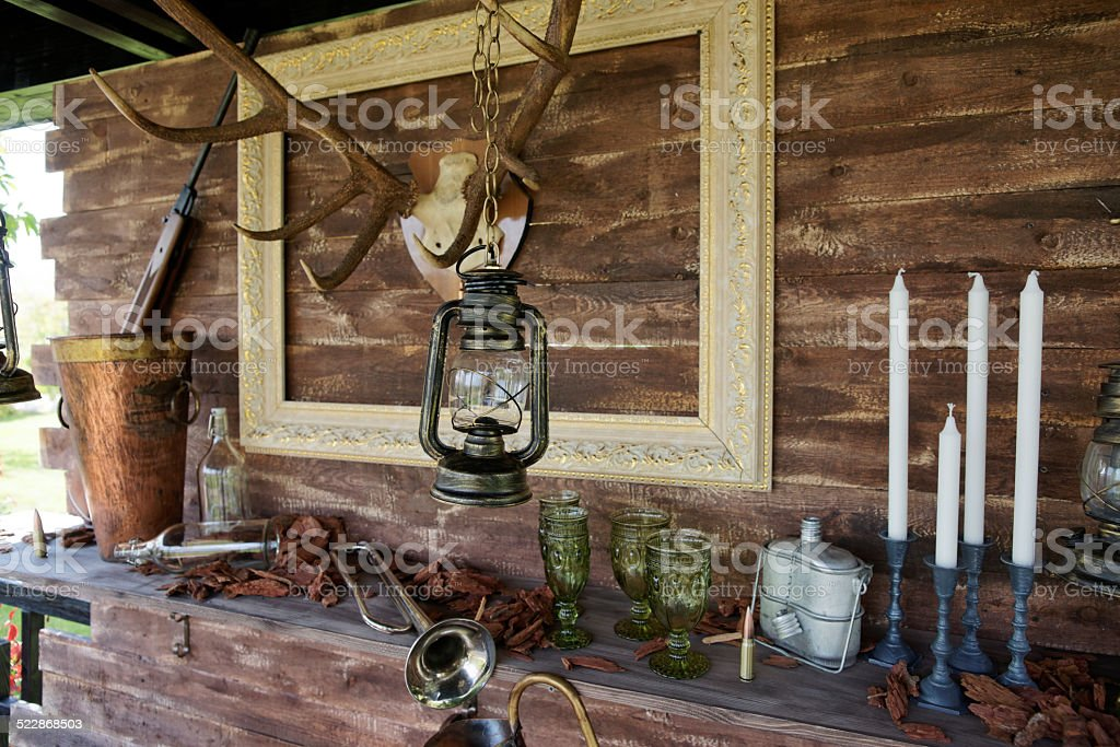 Hunting theme decoration of a summer house stock photo