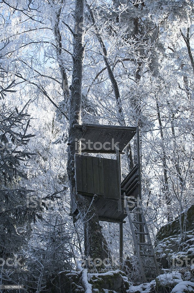 Hunting Tower in Winter Forest royalty-free stock photo