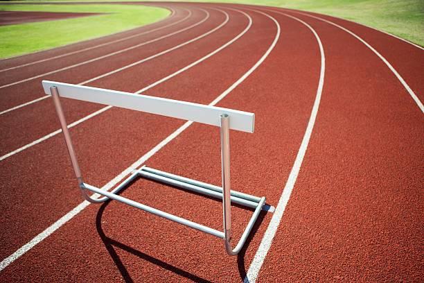 Hurdle on an athletic track - foto de acervo