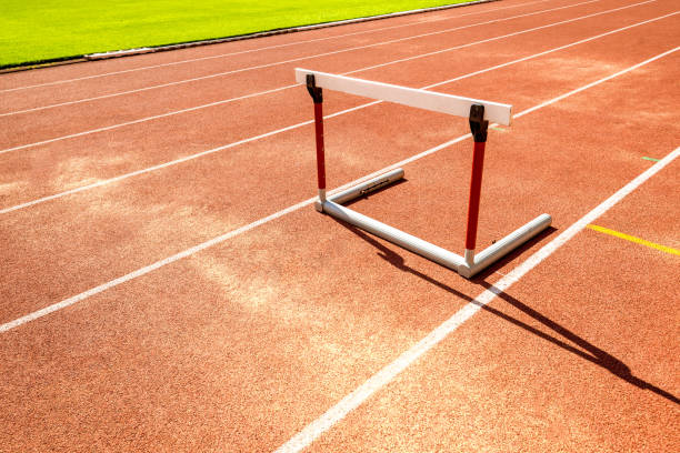 hurdle race barrier on red  running track , athletic stadium stock photo