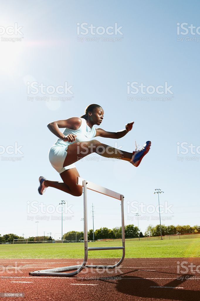 Hurdler in air stock photo