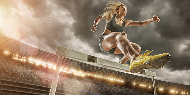 hurdler in extreme close up - obstacle run stockfoto's en -beelden