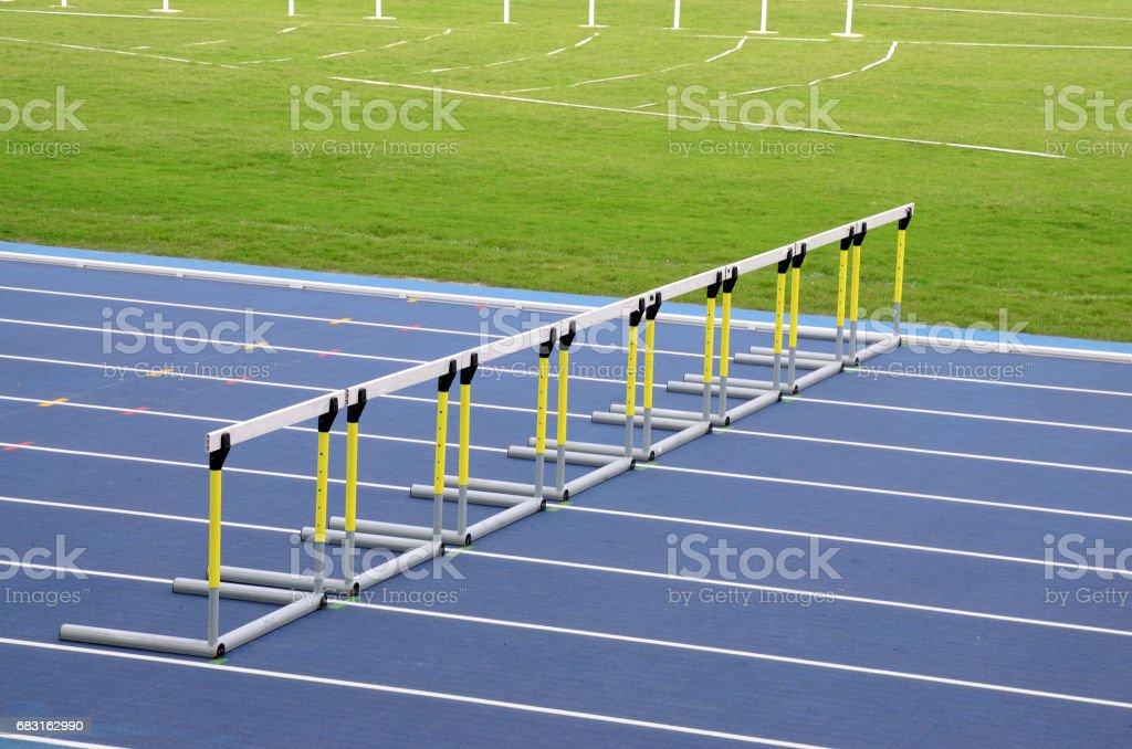 Hurdles on empty running track stock photo