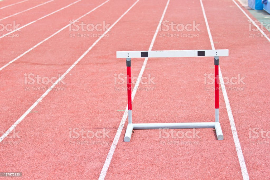 hurdles on the red running track royalty-free stock photo