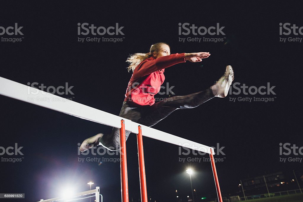Hurdling Young Athlete stock photo