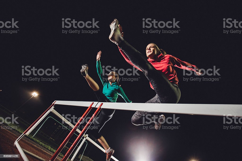 Hurdling Young Athletes stock photo