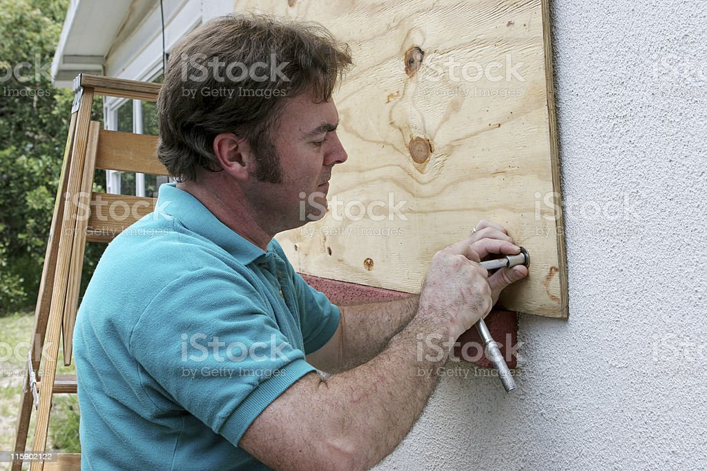 Hurrican Preparedness - Attaching Plywood royalty-free stock photo