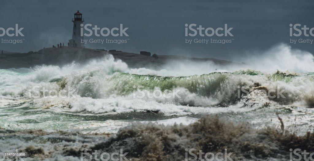 Hurricane Arthur lashes the Atlantic coast at Peggy\'s Cove Lighthouse.