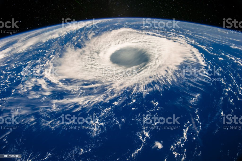 Hurricane eye on Earth viewed from space. Satellite view. Elements of...