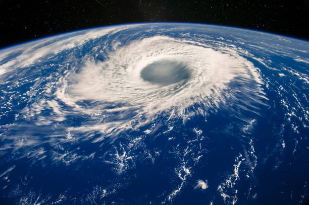 Hurricane eye on Earth viewed from space. Satellite view. Elements of this image furnished by NASA. Typhoon Nabi, 2005. Hurricane eye on Earth viewed from space. Satellite view. Elements of this image furnished by NASA. Typhoon Nabi, 2005. climate change stock pictures, royalty-free photos & images