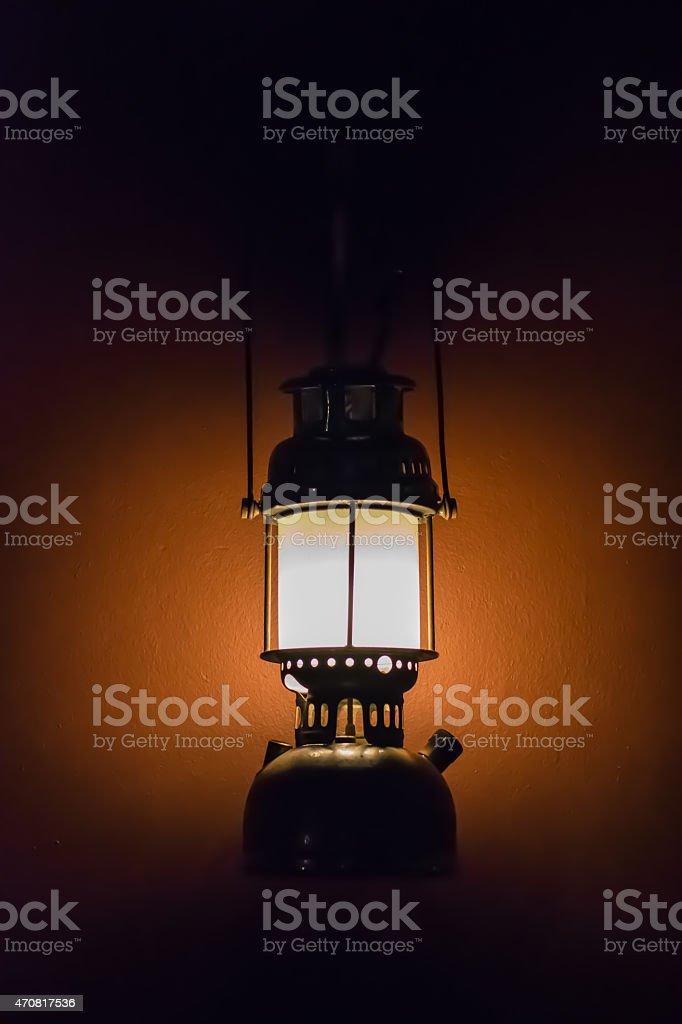 Hurricane lamp in the dark. stock photo