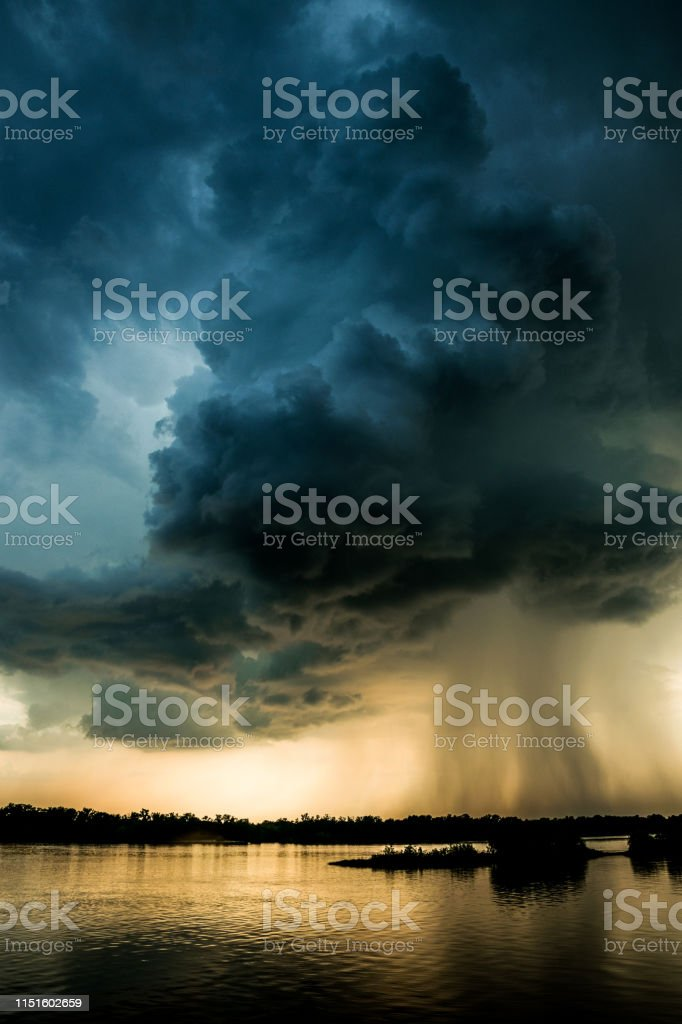 Rain over louisiana. Storm storm clouds in the rays of the evening...