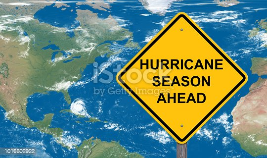 Hurricane Season Ahead Caution Sign With Satellite Map Background