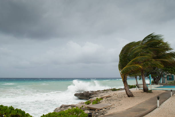 Hurricane storm surge in the Caribbean the Caribbean coastline of Grand Cayman gets battered in a hurricane. hurricane storm stock pictures, royalty-free photos & images
