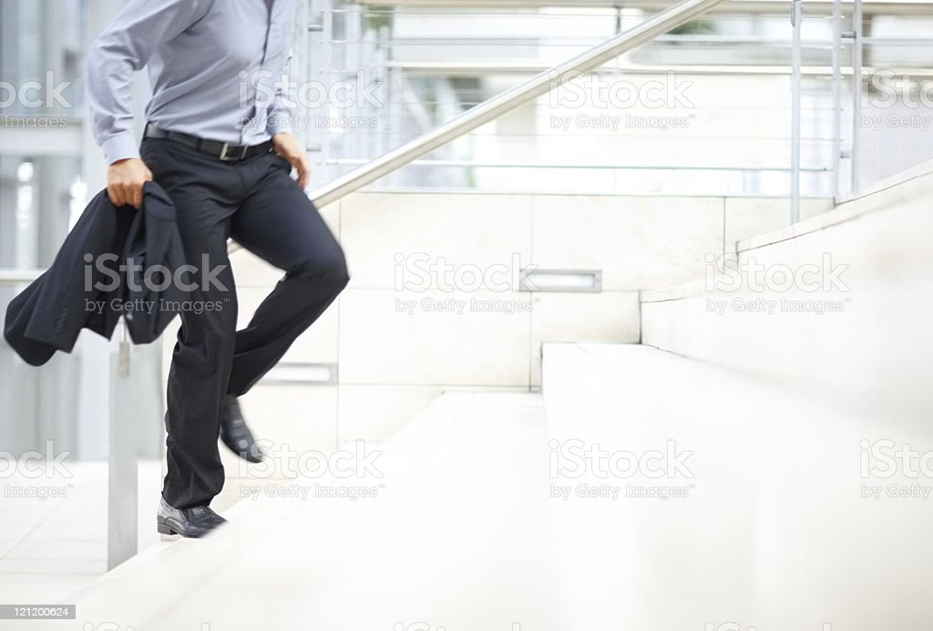 Hurry - Business man climbing up the stairs royalty-free stock photo