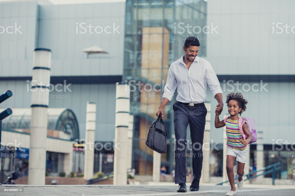 Hurry up baby, we are going late to school! stock photo