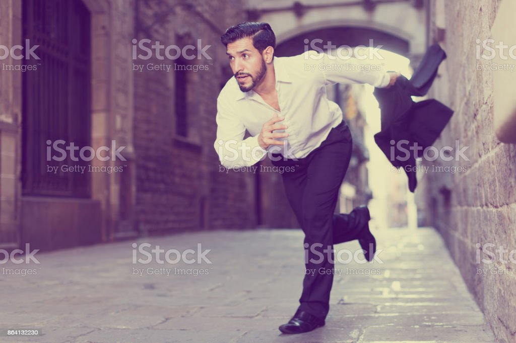 Hurrying man running along old street royalty-free stock photo