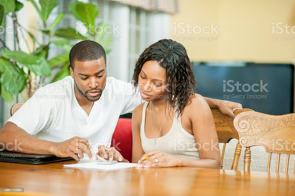 Husband and Wife Balancing Their Budget stock photo
