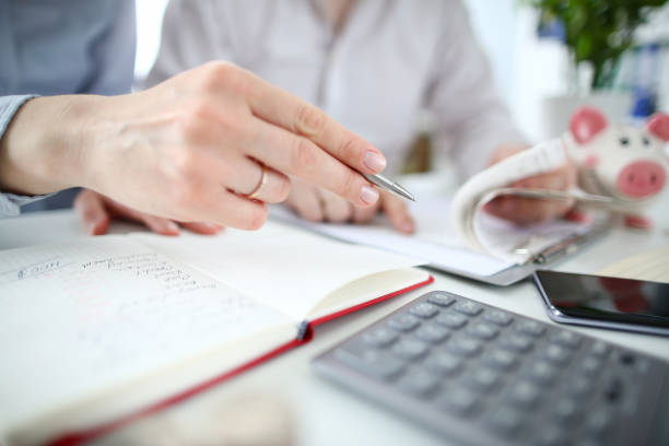 Husband and wife calculate expenses stock photo
