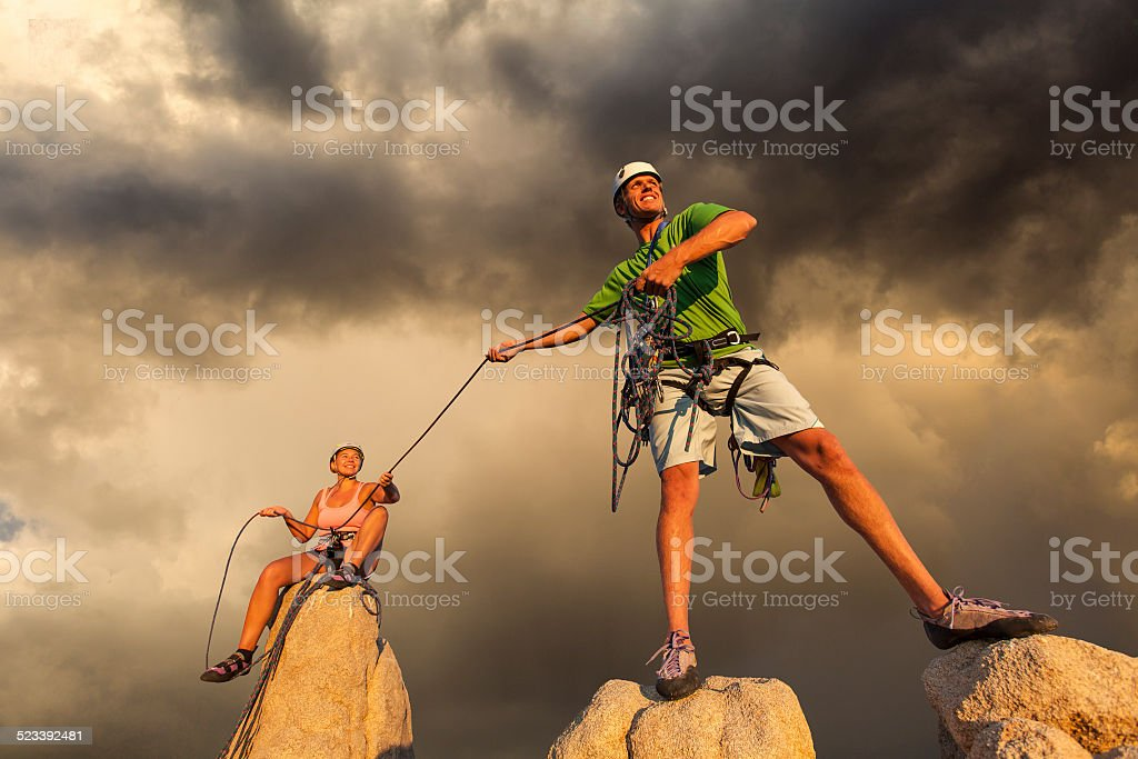 Husband and wife climbing team on the summit of a challenging ascent.