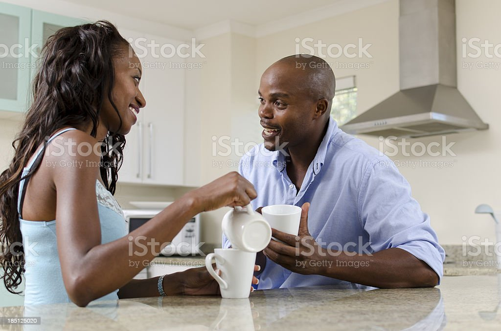 Husband and wife drinking coffee at home stock photo